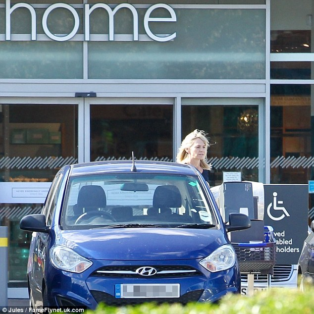 Relaxed: Wearing her blonde hair loose, she pushed a trolley of goods to her car where she loaded up the goods