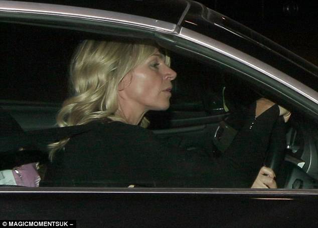 Moving on: Zoe was pictured driving away from ITV studios in London on Friday not wearing her wedding ring