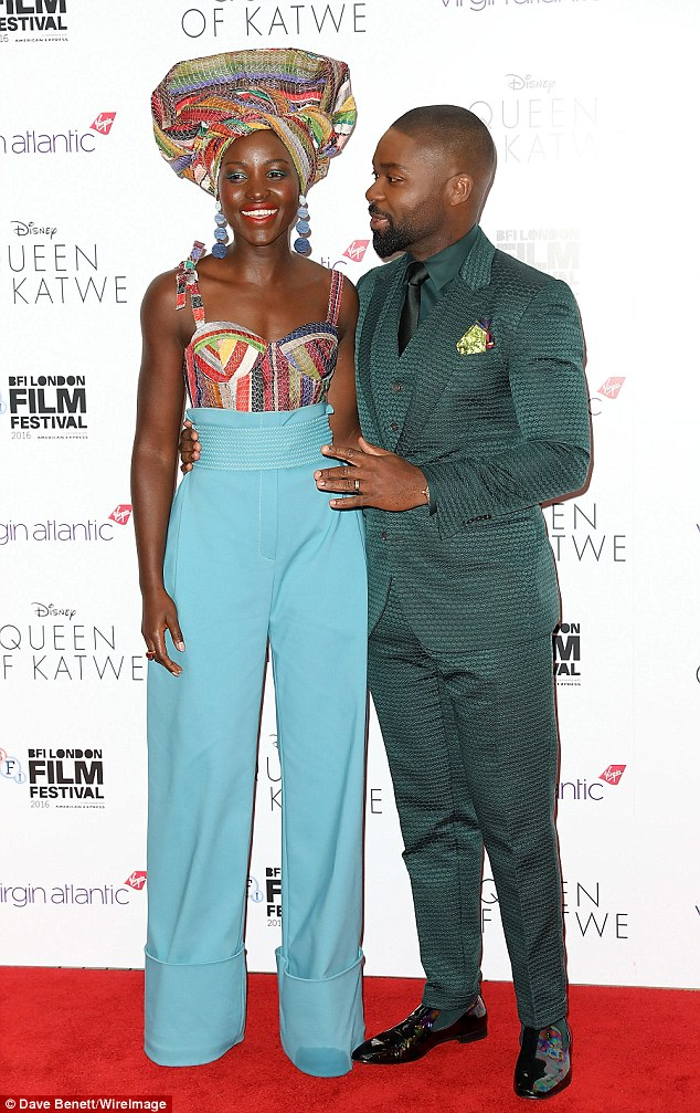 Dapper co-star: She was joined by her co-star DavidOyelowo, who looked dapper in a green textured three-piece suit