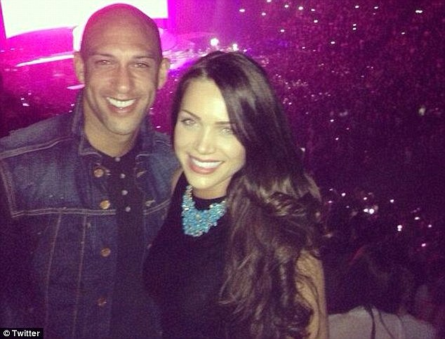Couple: The 25-year-old met US footballer Tim Howard at a party almost four years ago and was last photographed with him in Florida last year.