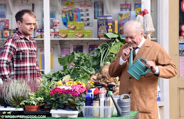 On set: The 76-year-old looked in his element as he filmed scenes for the news series and Christmas special in Doncaster with an array of hilarious props