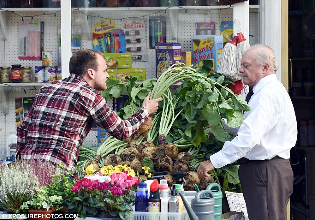 Hands off: David gave his fellow co-star the eye as lunged towards his turnip offering
