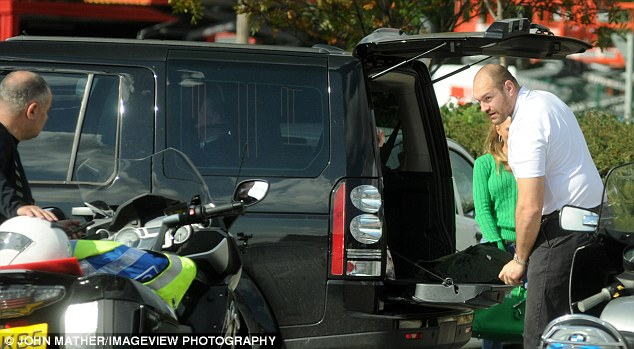 Arduous task: The heavyweight champion, 28, had finished shopping at Spa supermarket in Morecome, Lancaster with his wife Paris when he battled with the boot to fit the pram in