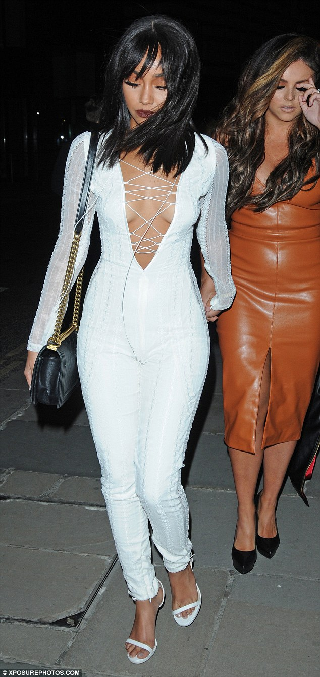 Bright white: The jumpsuit showed off her tiny waist and perfectly proportioned hips