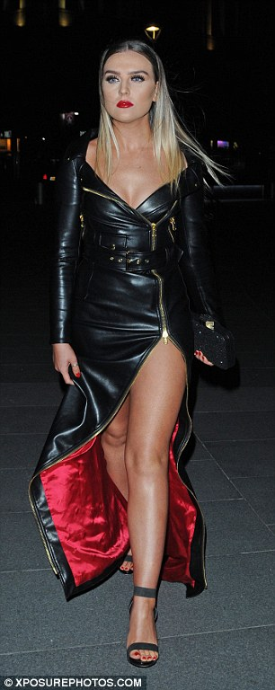 Vamp chic: Perrie looked like she was ready to rock in a seductive leather number with a red silk lining and a very high side split