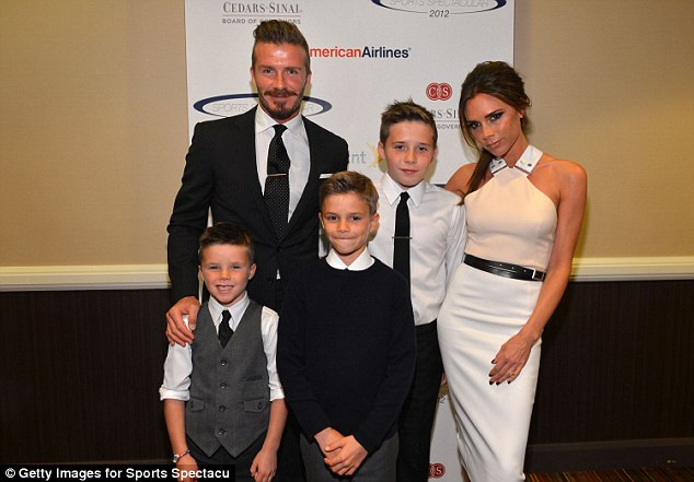 Loving mother: Victoria with her sons (L-R) Cruz, Romeo and Brooklyn Beckham in 2012