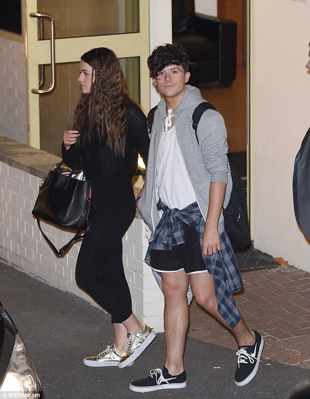 Holding hands: X Factor lovebirds Emily Middlemas and Ryan Lawrie were seen holding hands as they left later that night