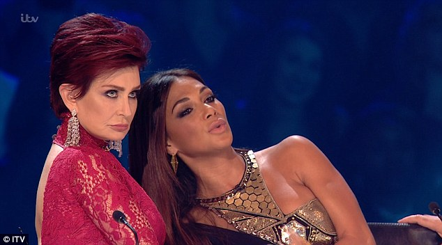 Up close and personal: Sharon and Nicole joked around as the first of the live shows got off to a flying start