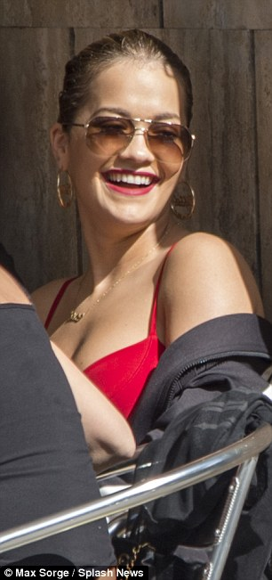 Red hot: Rita Ora continued her fashionable domination in a plunging red bustier style top as she enjoyed her final few hours of holiday in Rome on Thursday before getting back to Heathrow Airport