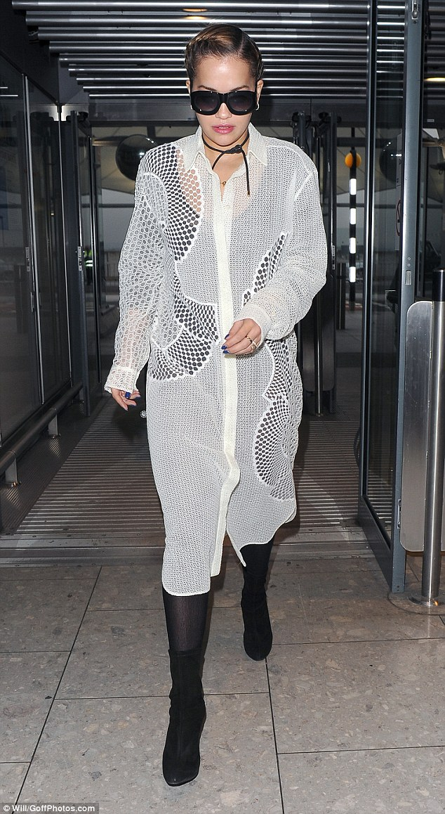 Jet-setter: The singer's time back in Britain was a short one, as she headed back to Heathrow Airport on Friday morning to fly off once again