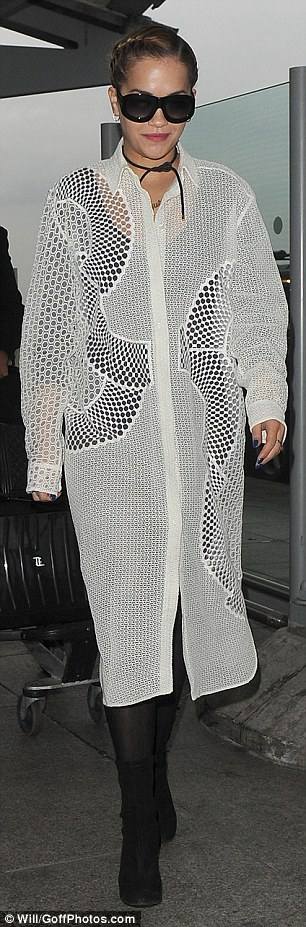 Early bird: Despite the early hours, Rita didn't falter when it came to looking her best as she donned a unique laser cut-out coat which skimmed her black ensemble underneath