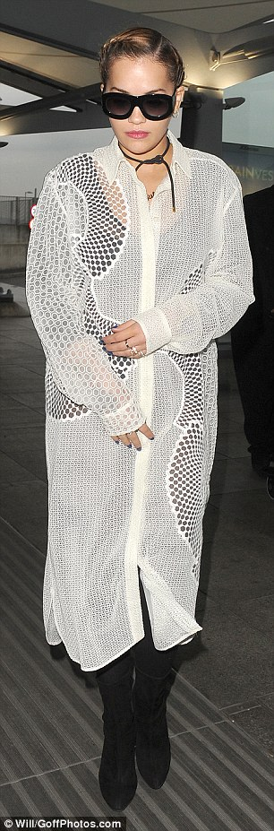 Hot: She was wrapped up warm in the emerging London chill