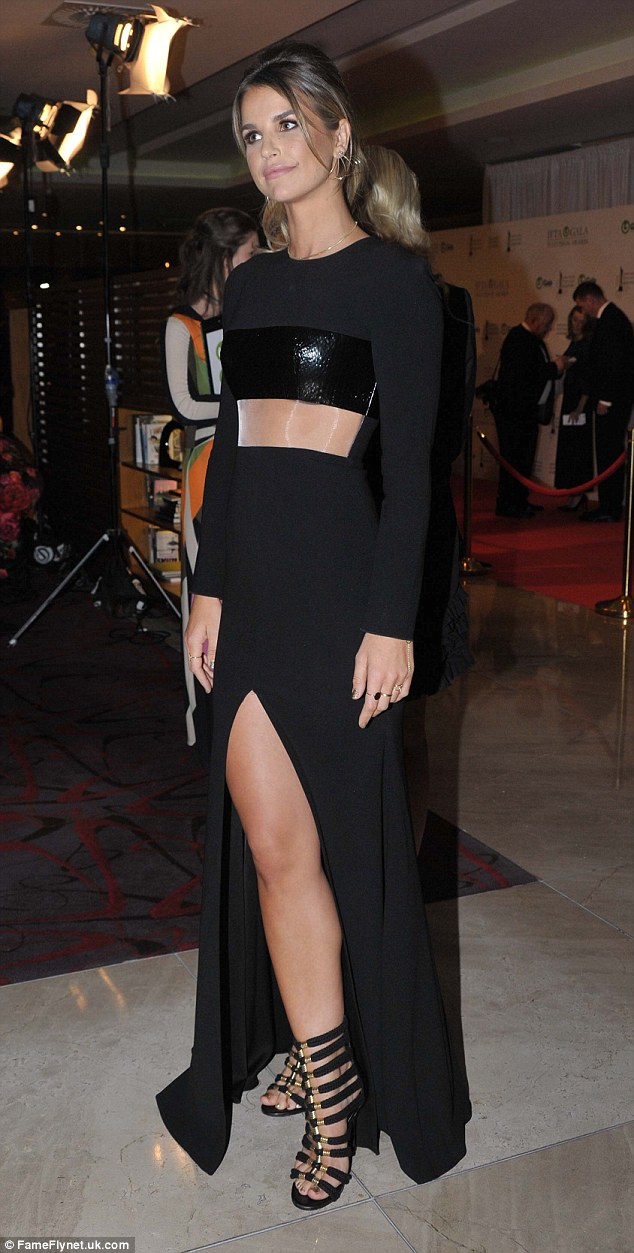 Elegant: Vogue ensured all eyes were on her, drawing attention to her tiny waist in the floor-length number, which boasted a sheer panel at the waist