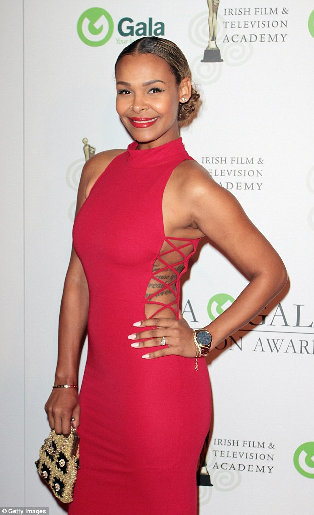 Lady in red: Samantha Mumba showed off her tattooed side in a slinky red number