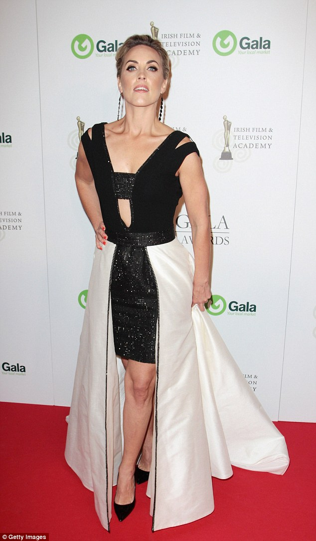 Unique: Kathryn Thomas put her best foot forward in an unusual dress with a zip up skirt