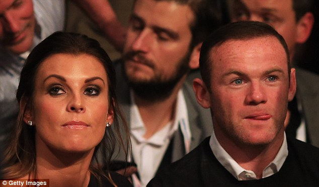 Coleen Rooney (left) defender her husband Wayne after hearing criticism on the radio