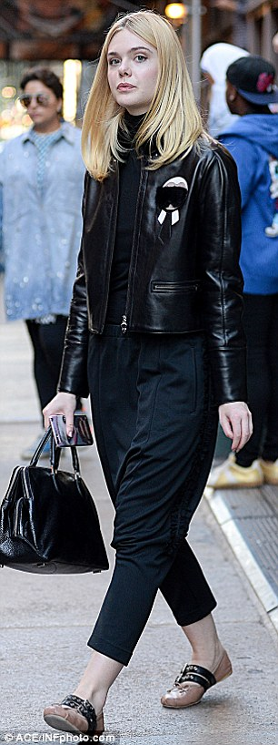 Eye-catching: She wore a stylish pair of midnight blue drop crotch trousers