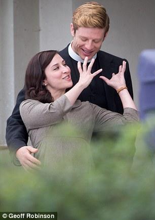 Larking around: She looked ready to jokingly choke him