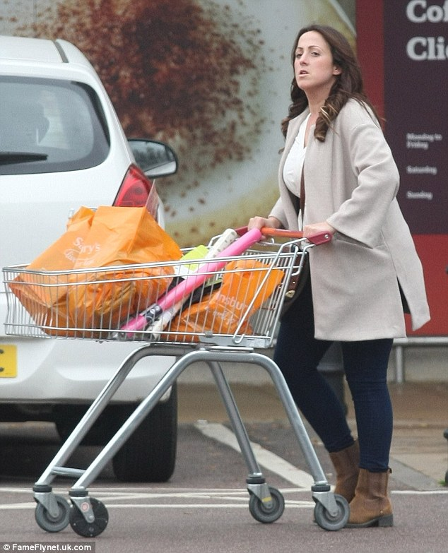 Yummy mummy: Natalie Cassidy looked the picture of health as she headed out to do a grocery shop in Hoddesdon, Hertfordshire on Sunday