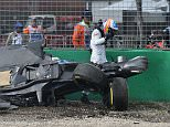 McLaren driver Fernando Alonso of Spain emerges from the wreck of his car after he collided with Haas driver Esteban Gutierrez of Mexico during the Australian Formula One Grand Prix at Albert Park in Melbourne, Australia, Sunday, March 20, 2016. (AP Photo/Theo Karanikos)