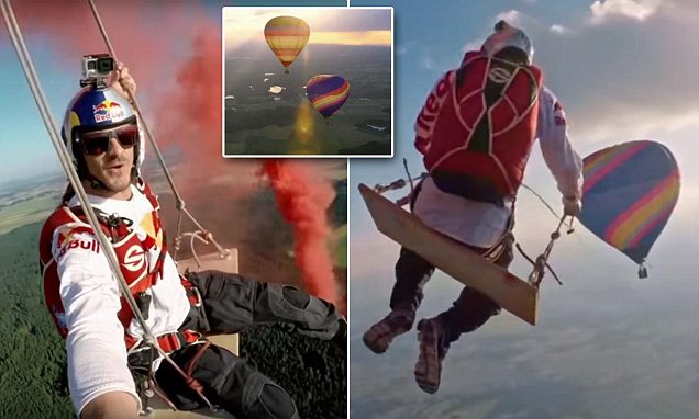 Moment skydivers ride on world's biggest swing suspended between two hot air balloons