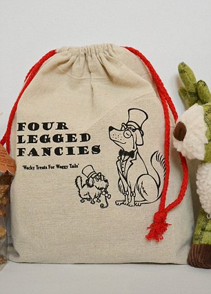 Festive fun for dogs who get their very own Santa sack