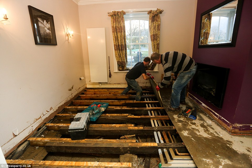 Some of the damage to a property in Keswick in Cumbria is pictured. The home was devastated by flood waters at the weekend