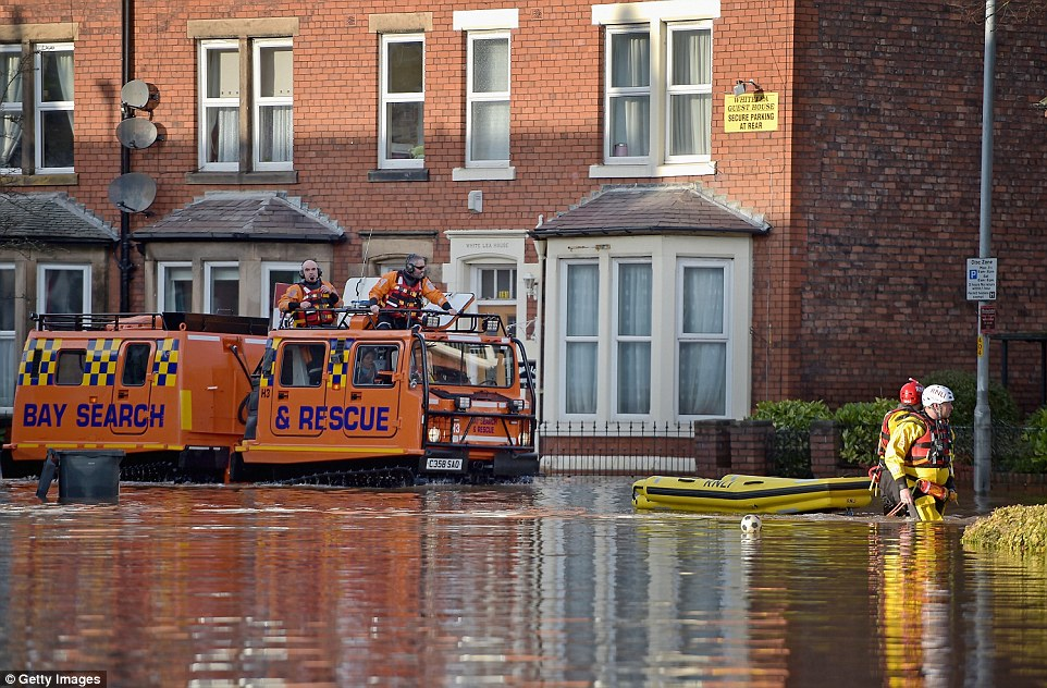 Rescue teams continue to to evacuate people from their homes in Carlisle as forecasters confirm a record amount of rain fell this weekend