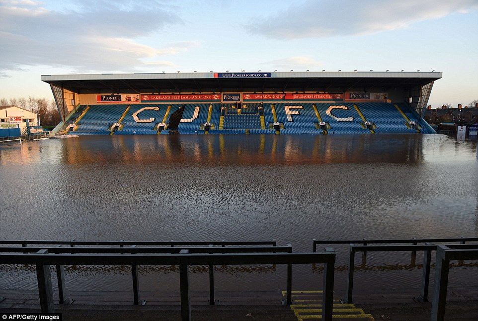 Floodwater covers the pitch and some of the stands at Carlisle United Football Club's Brunton Park stadium after heavy rain this weekend