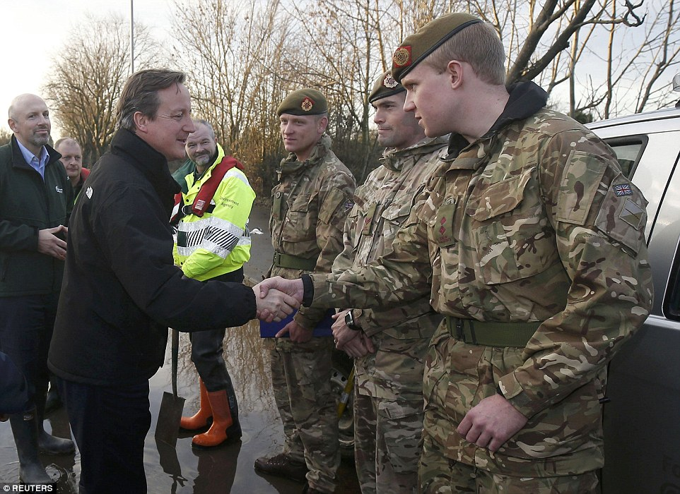 The Prime Minister shook the hands of troops in Warwick Road, Carlisle, yesterday as he thanked them for their help evacuating residents