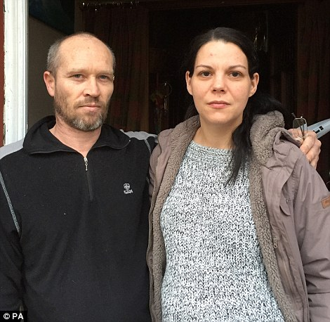 Heartbroken Julie Hannah and her husband Campbell (pictured) are trying to clear up their house, left devastated by floods