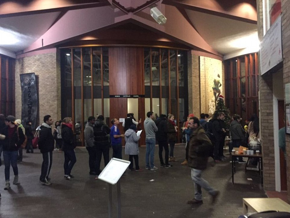 Students can be seen queuing up to enter Lancaster University's Great Hall after being evacuated from their accommodation yesterday