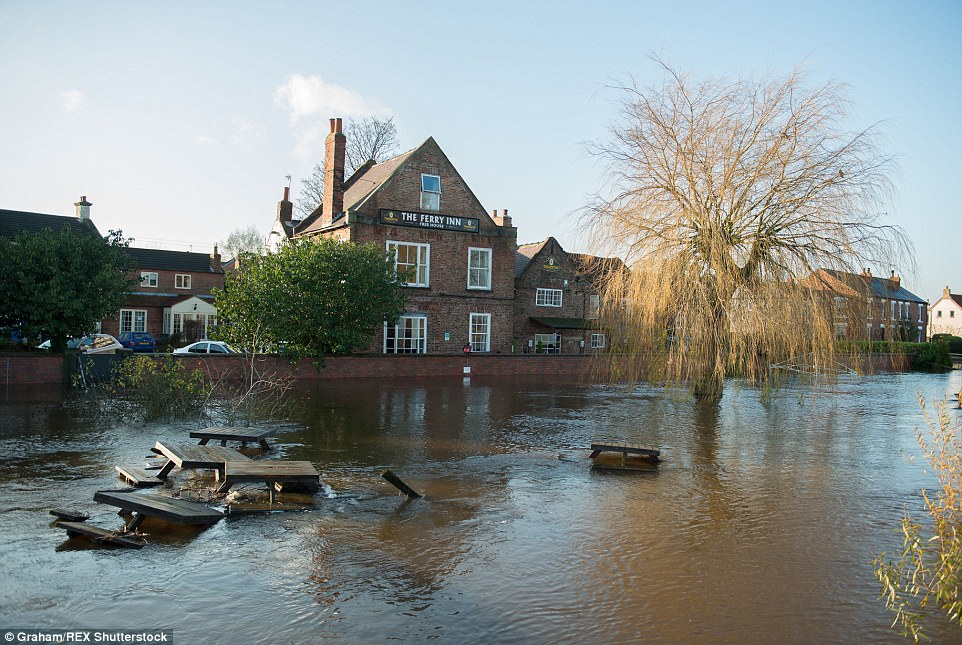 In Yorkshire, the beer garden of The Ferry Inn pub in Cawood was under water after the River Ouse flooded following Storm Desmond
