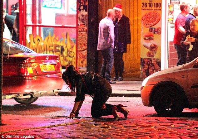 Fallen: A drunk woman stumbles to the ground near the path of oncoming traffic in Newcastle