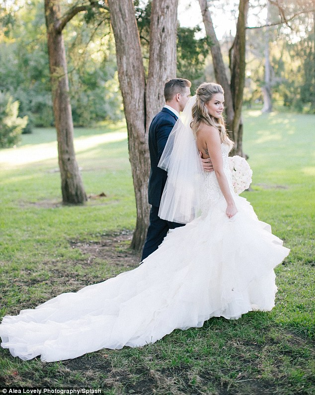 'Princess feels':The 29-year-old pediatric nurse looked stunning for her big day in a strapless fishtail gown with tulle skirt and lace and crystal embellishment on the bodice