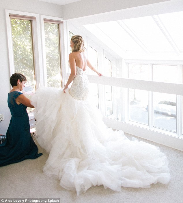Phenomenal! Nikki walked down the aisle in a strapless gown with dramatic, voluminous train