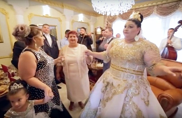 The bride shows off her £175,000 dress in what was the ultimate gypsy wedding in Slovakia