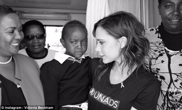 Doting mother: Victoria, 42, joined Brooklyn on the trip to Kenya with UNAIDS to learn more about HIV treatmeants available, as the charity's ambassador