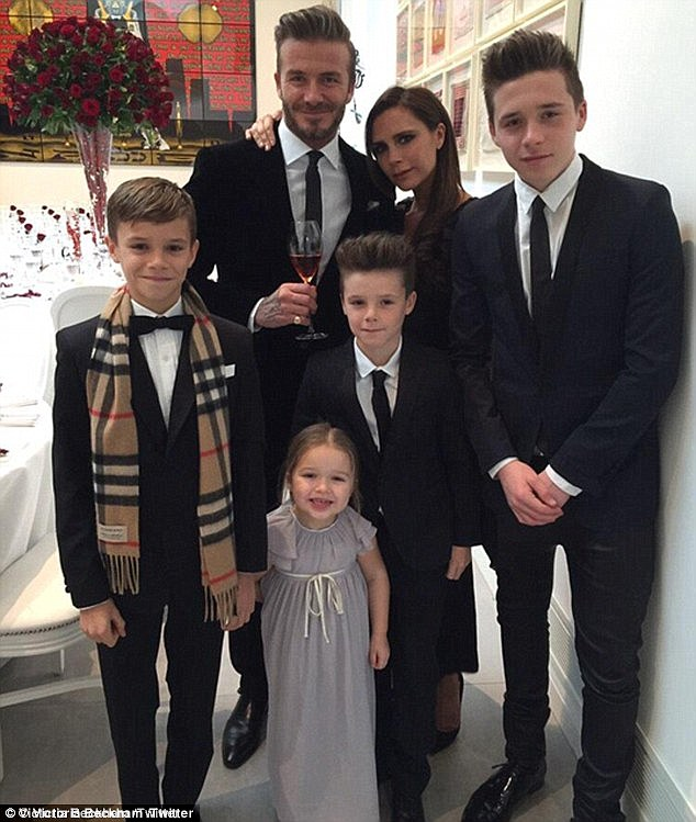Happy family: Victoria is also mother to sons Romeo, 13, and Cruz, 11, and daughter Harper, 5, with husband David Beckham, 41