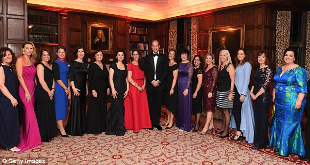 The father-of-two posed for a group photograph among some of the female hedge funders who were all glamorously dressed for the occasion
