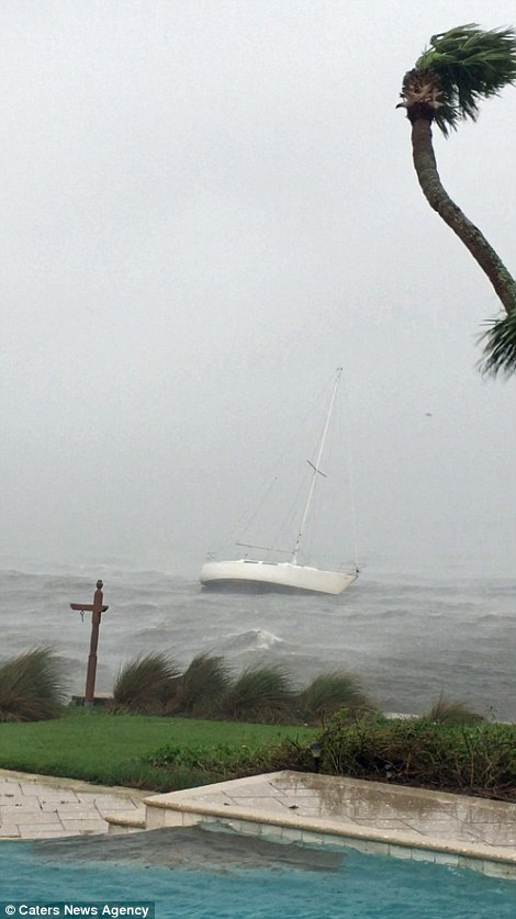Hurricane Matthew caused multiple sail boats to become unmoored from Halifax Harbour Marina, Florida, USA, and float three miles down the Halifax River