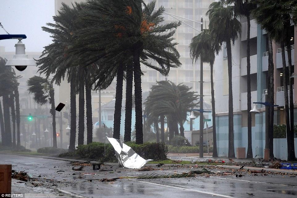Debris flies through the air as the eye of Hurricane Matthew nears Daytona Beach; there are signs that a direct hit with land will be avoided if the hurricane continues to move in a northerly direction