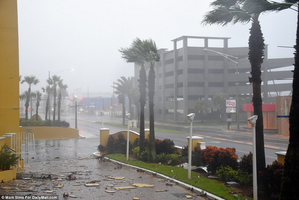Braced for flooding: Daytona Beach at 8.30am was being battered as wind began to pick up, with the first signs of damage and debris
