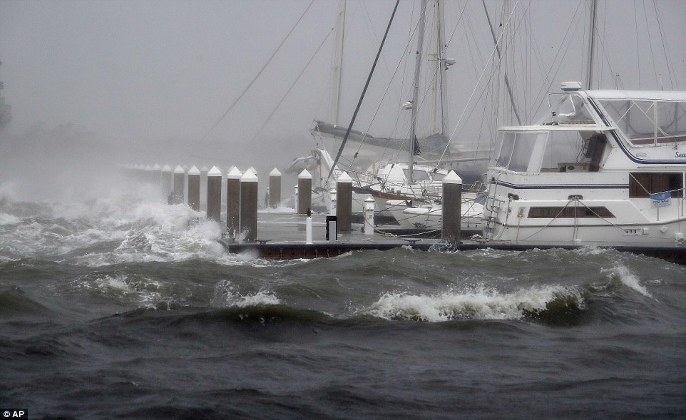 Batten down the hatches: Waves from Hurricane Matthew batter a boat dock in St Augustine; the storm was downgraded to Category three overnight but is still a fierce one