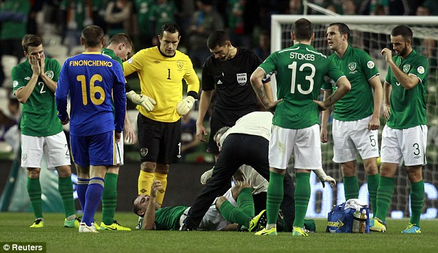 Everton blow: Gibson is facing the prospect of months on the sidelines after sustaining a knee injury