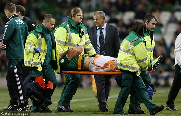 Agony: Darron Gibson is taken off on a stretcher after sustaining a knee injury in Ireland's clash with Kazakhstan