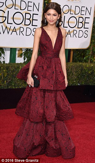 Multi level: Monique Lhullier's three tier gown with a plunging neckline (right) reminded us of the gorgeous burgundy number that Zendaya, 20, wore to this years Golden Globes (left)