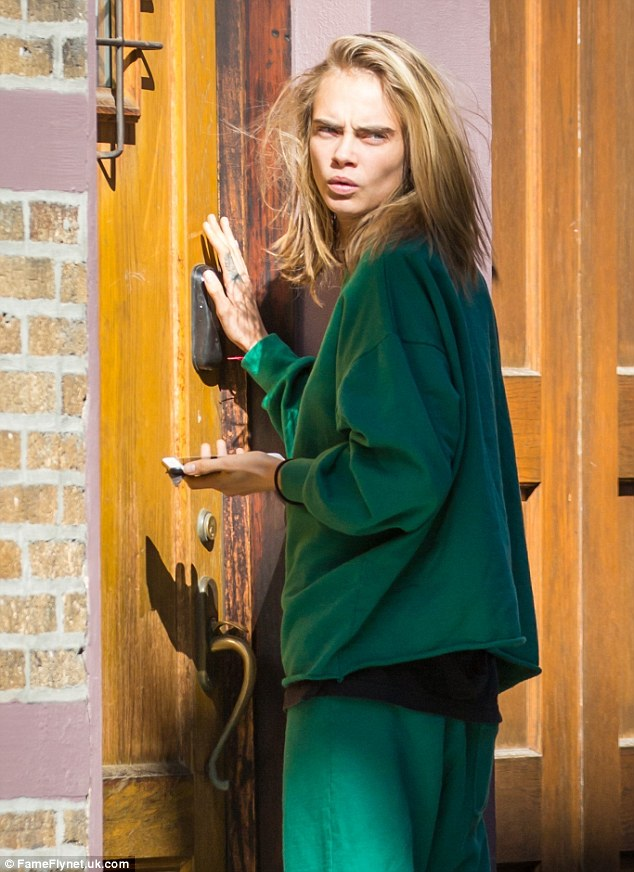 Green with envy: Cara has been known for her off-duty Tomboy style when she is away from the camera or runway, yet Monday's appearance was beyond her usual look