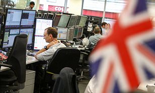 FTSE 100 hits all-time trading high as pound slides below $1.23 on 'hard Brexit' fear