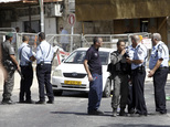 Israeli police secures the scene where a car driven by a Palestinian gunman was intercepted by the police and gunman shot dead in Jerusalem Sunday, Oct. 9, 2016. A Palestinian motorist launched a shooting spree near the Israeli police headquarters in Jerusalem Sunday, killing  two and wounding several more  before being shot dead, Israeli police and emergency services said. (AP Photo/Mahmoud Illean)